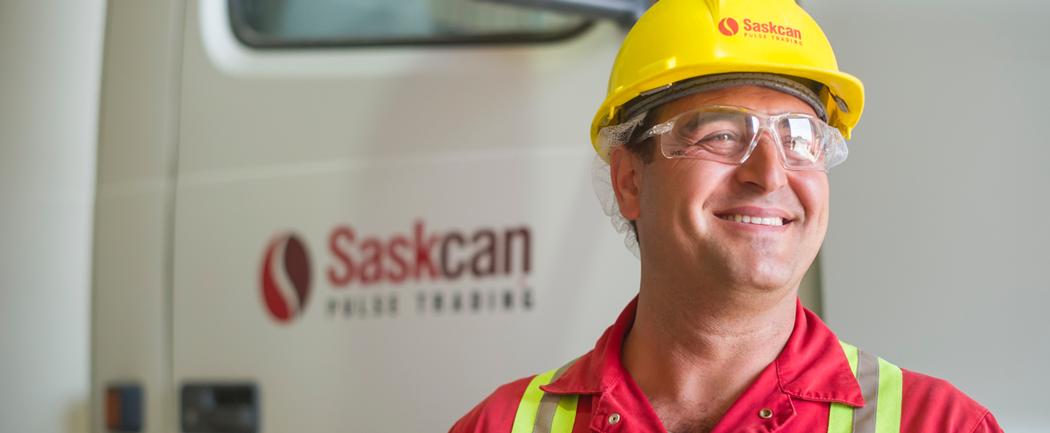 Saskcan employee in front of truck