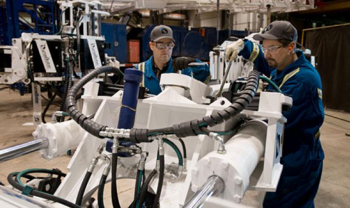 Two Saskatchewan manufacturing workers